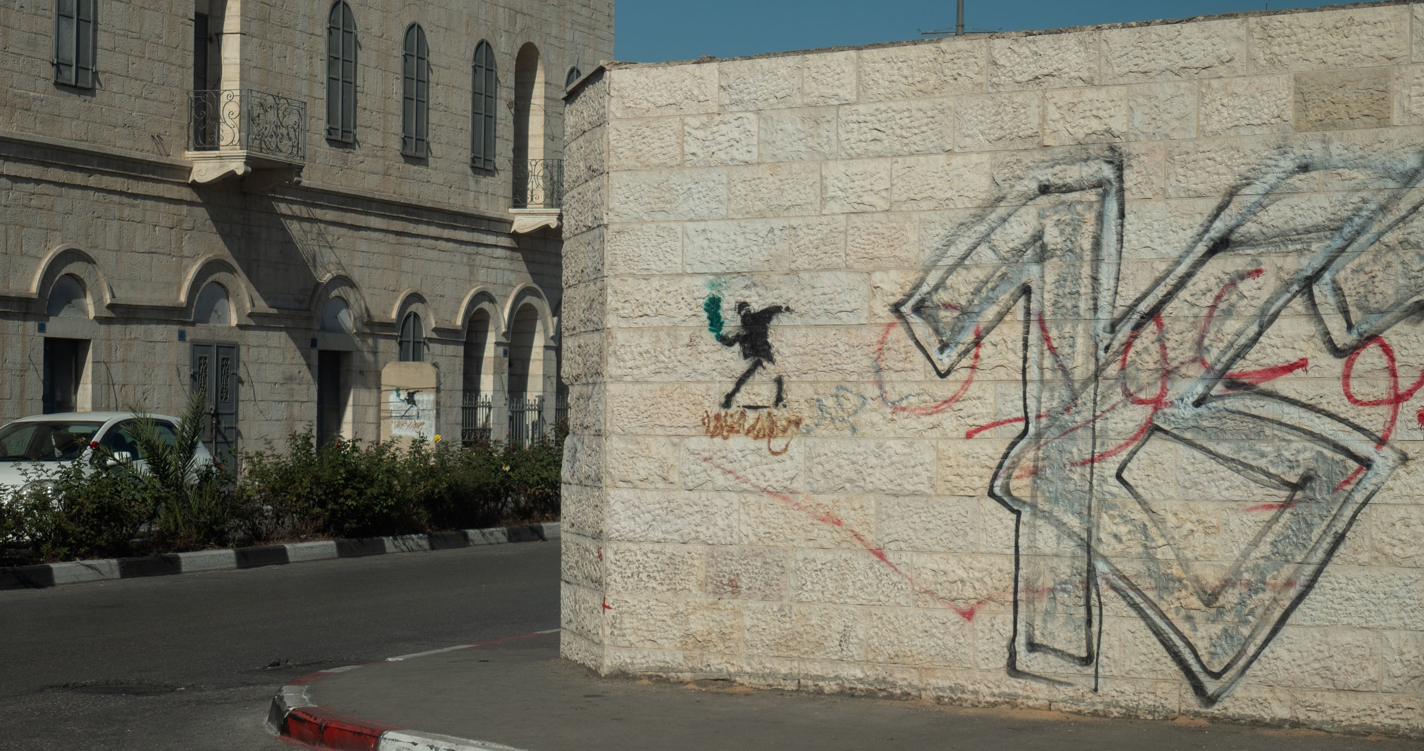 "Originally spotted in Jerusalem, the ""Flower Bomber"" or ""Rage, Flower Thrower"" is located in the heart of the Israeli-Palestinian conflict – not only decorating the hotel lobby, but also several walls around the West Bank and Israel. The artwork is one of the most famous art pieces by Banksy and provides a universal message: the power of civil and non-violent resistance. Photo/Mathias Birsens"